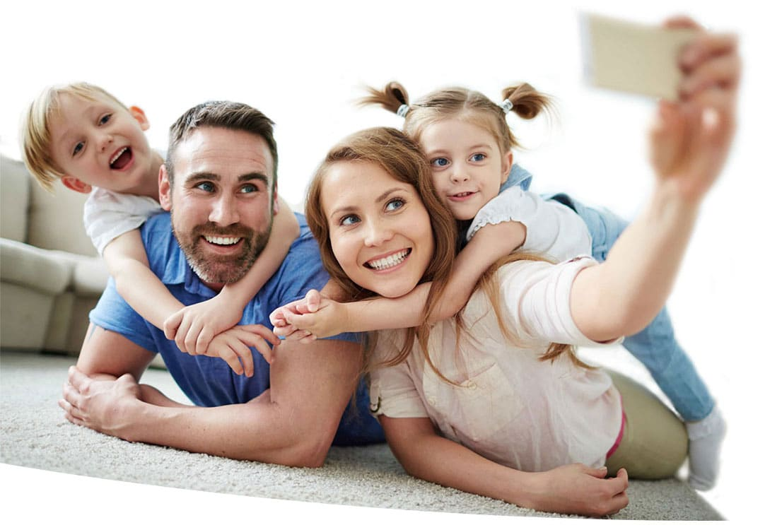 Happy family taking selfie on the floor at home.